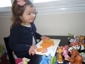 Don't underestimate the power of pretend play.  Reading to a captive audience of animals is a great way for your little one to engage and model behavior, while learning through teaching.